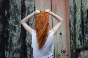 Image of the back of a girl with red hair, Anne of Green Gables