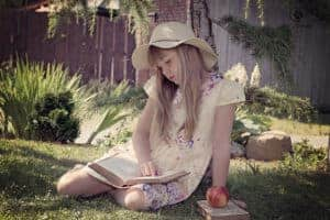 Image showing a girl reading and enjoying the freedom and sensibility of a Christian classical education.