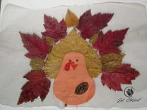 image of turkey placemat made with fall leaves for remembering Thanksgiving