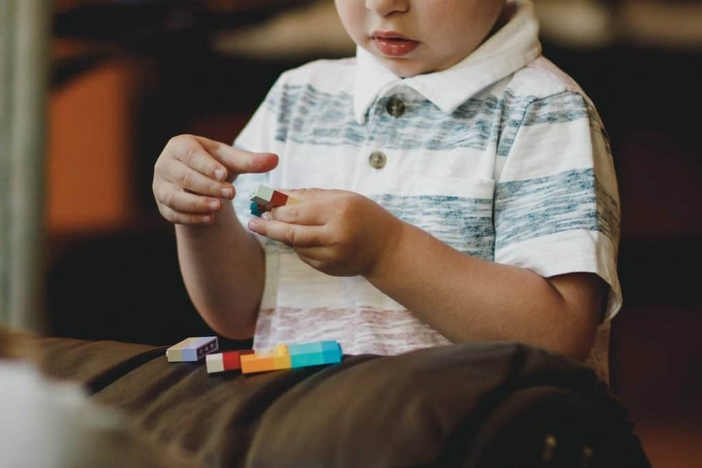 Boy playing with legos in tips for homeschool moms