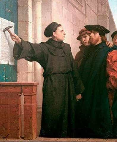 Painting of Martin Luther nailing 95 Theses on church door at start of Protestant Reformation.