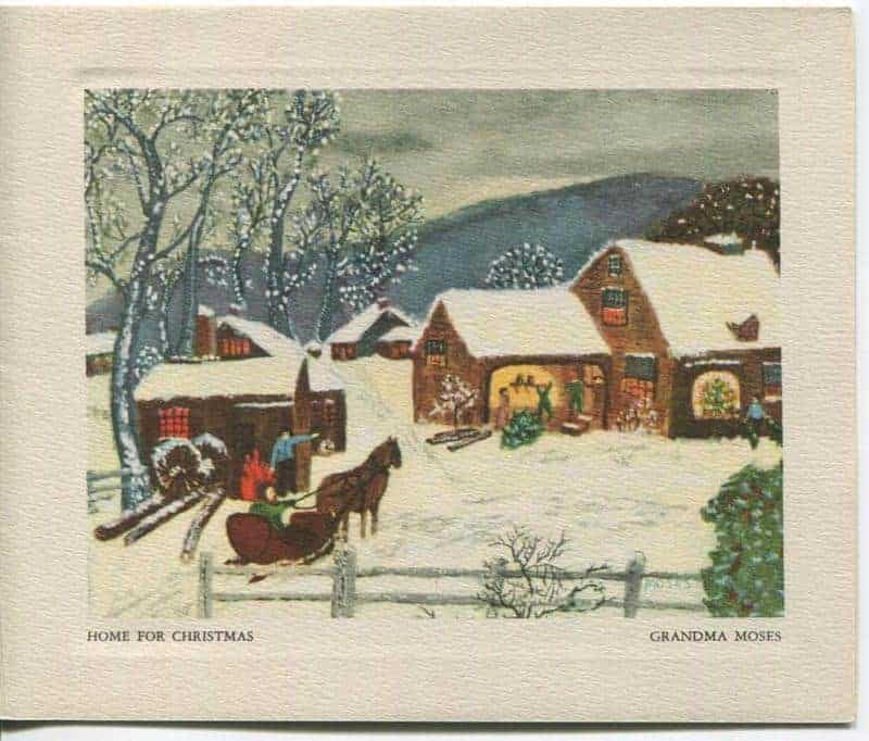 Greeting card with painting of a winter scene where snow covers a yard of a brown house and horses lead in a sleigh. The painting is called Home for Christmas by Grandma Moses.