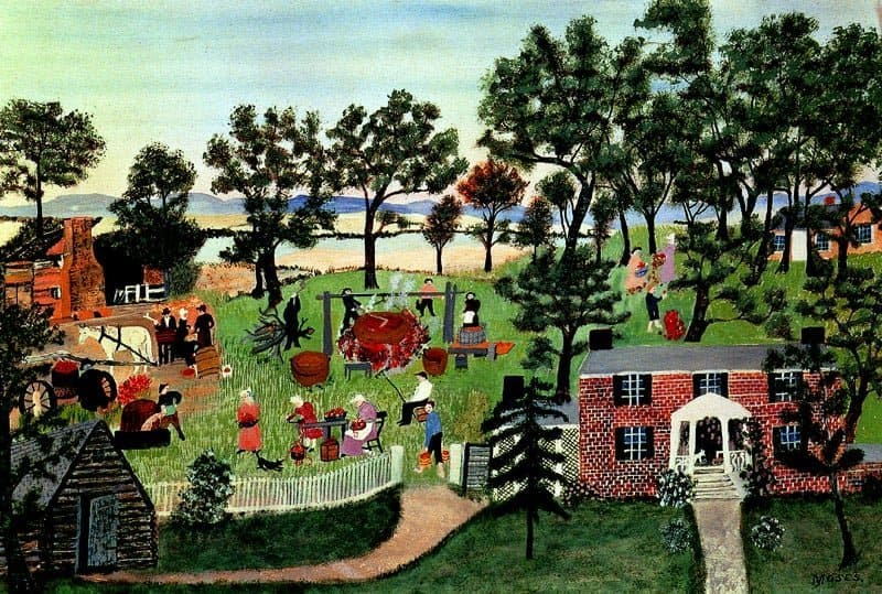 Painting with log cabin in lower left corner and checkered red and white house on the left front side. In the field beyond is a group of men and women cooking in a cauldron over a bonfire in a painting by Grandma Moses called Apple Butter Making.